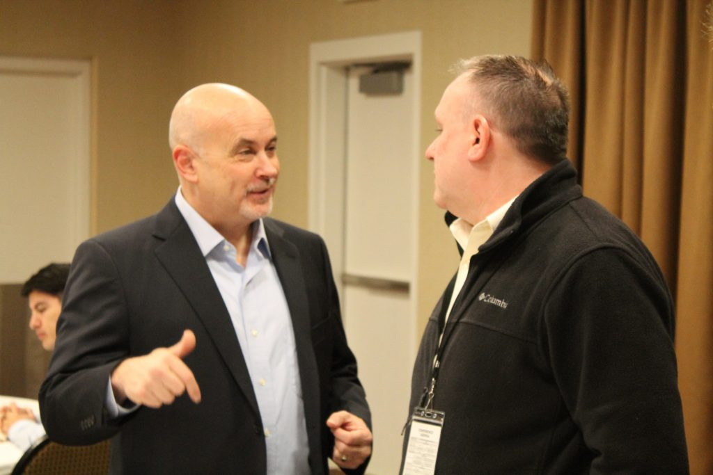Congressman Mark Pocan talking to a local elected official.
